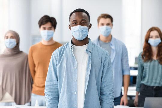 Diverse group of international people wearing medical masks