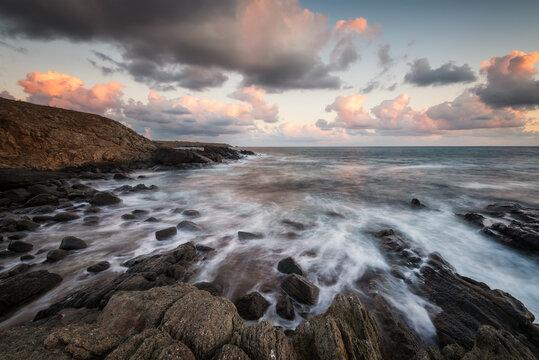 Stormy sea with sunrise sky at a rocky coastline, the Black Sea coast, Bulgaria
