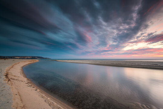 Amazing sunrise view with colorful reflections at the wild Black Sea coast and the mouth of the Kamchia River