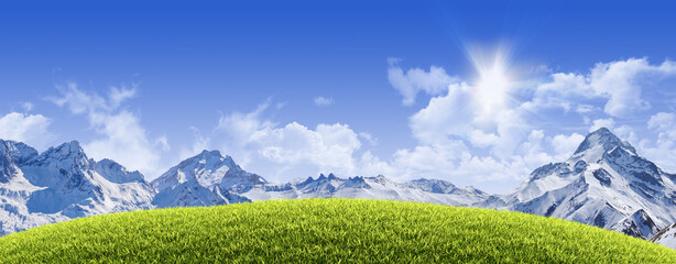 Sunny natural background with grassy hill, snowy high mountain peaks and clear blue sky - great copy-space for posters, cards or banners (all composition elements shot by myself)
