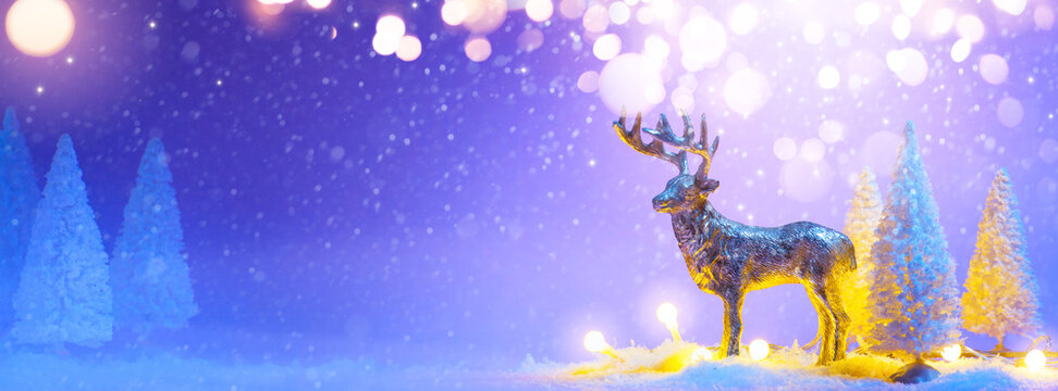 A Christmas greeting card or banner background;  santas reindeer and snowy tree decoration
