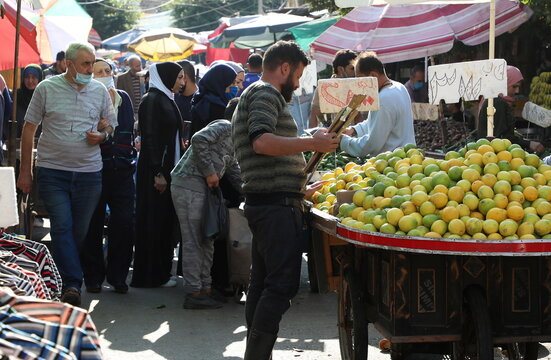 People shop at a crowded souk as the Lebanese government ordered a national lockdown, to combat a resurgence of the coronavirus disease (COVID-19) outbreak