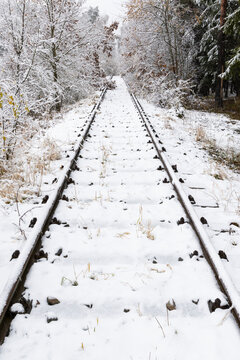 snowy canceled old railway track
