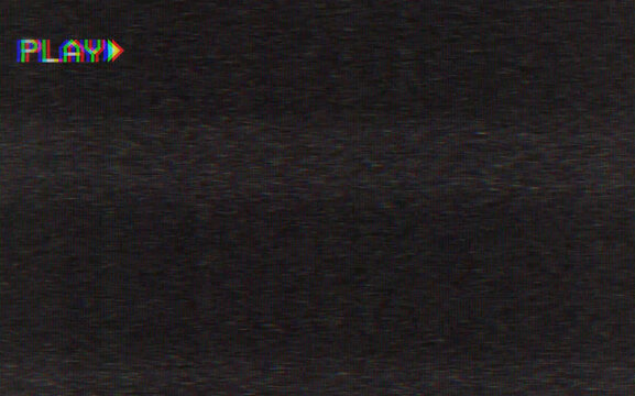 Old damaged VHS tape playing, over noise from an analog TV, with a PLAY text.