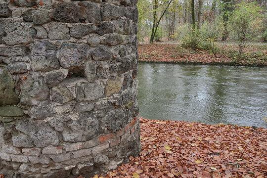 Old watch post near a water canal at Munich Englischer Garten in autumn,beautiful park in the heart of the city