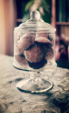 Glass container with soft almond cookies, comfort food and sweet treat