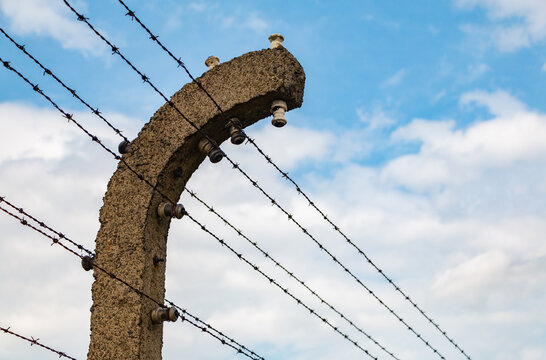 Auschwitz, Poland - September 10, 2017: A close-up picture of the security fence in the Auschwitz-Birkenau Camp.