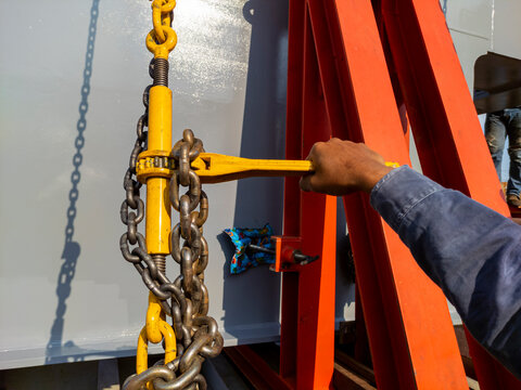Fastening of steel girder on trailer with ratchet binders or lever binders before delivery to site.