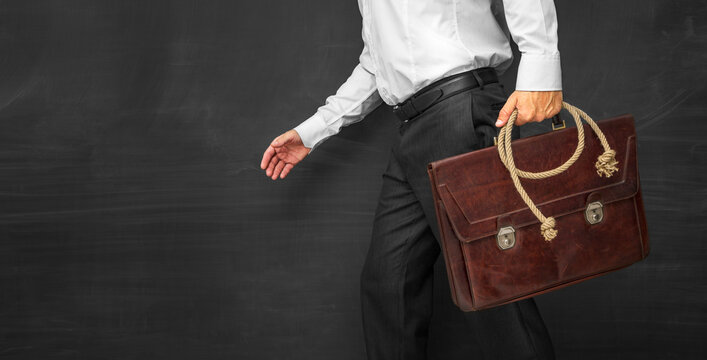 Failing business -Business man with briefcase and rope in hand