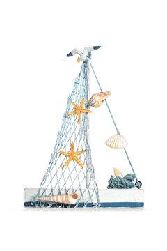 Beautiful decorative blue white sailboat with seashells, starfish and seagull