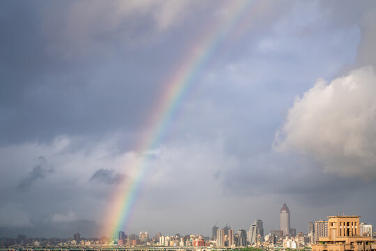 Skyline of taipei city in downtown Taipei, Taiwan.bright sun shining center top and a large rainbow