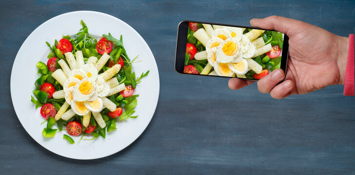 Photgraphing Fresh asparagus salat for posting on social media, free copy space, flat lay