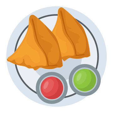 Break or tea time snack called samosas with two sauces
