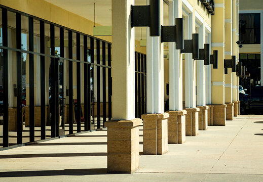 columns outside a strip mall of retail space in Conroe, TX