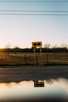 Beautiful golden hour reflection and yellow two way sign in Buda Texas