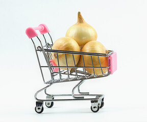 View of supermarket trolley cart with fresh onions isolated on white background. Food concept