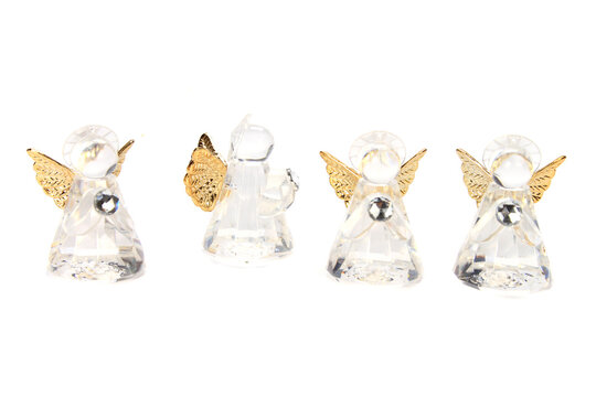 Closeup shot of glass angel figurines isolated on white background