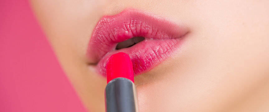 Lipstick. Make up for lips. Lipstick and pomade. Close up pink lips. Pink lipstick. Pomade. Applying lipstick.