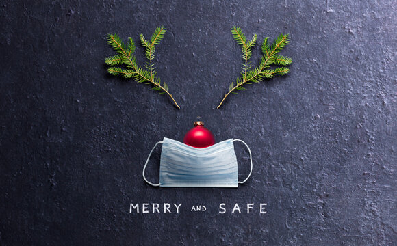 Minimal Christmas Concept - Merry And Safe - Reindeer Made With Face Mask And Decorations