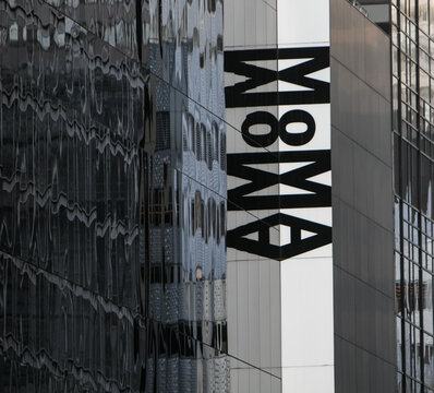 Museum of Modern Arts lettering and its mirror reflection in windows.