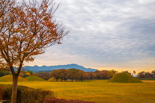 Sunset of Inwang-dong ancient tomb complex at autumn in Gyeongju, Korea