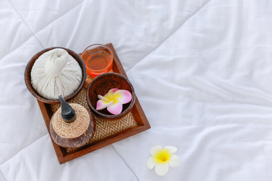 Beautiful composition of spa treatment on wooden table in the room