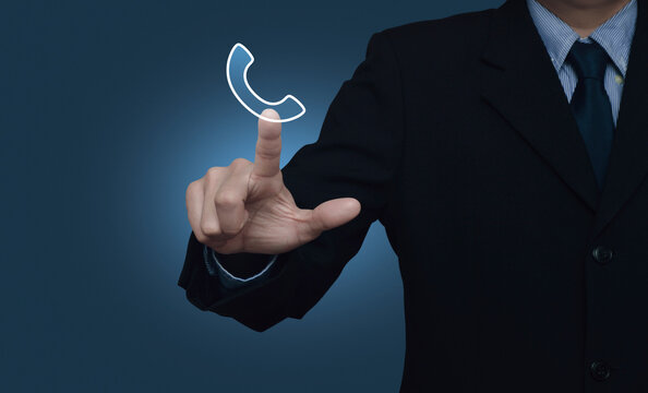 Businessman pressing telephone flat icon over gradient light blue background, Business contact us, Customer service and support concept