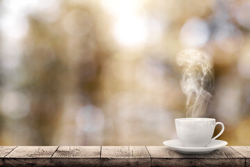 a hot coffee on the table on a spring background