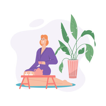 Happy woman in bathrobe drinking tea and relaxing in spa salon