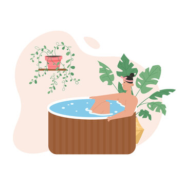 Smiling woman relaxing in wooden bathtub at spa salon
