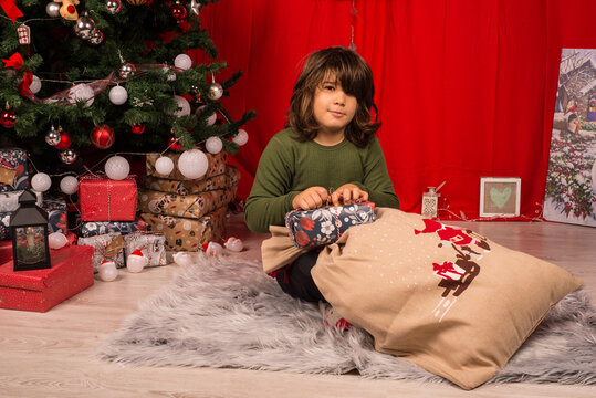 Boy taking a gift from sack