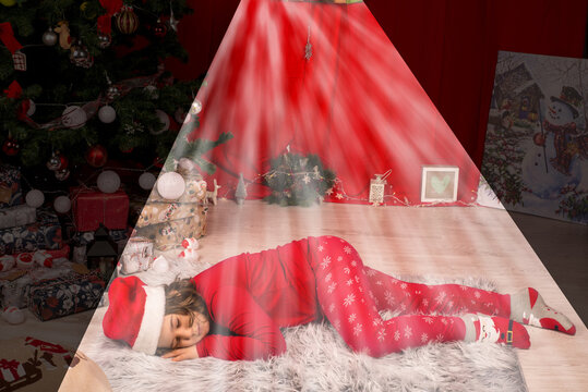 Sleeping boy in the Xmas night and a light over him