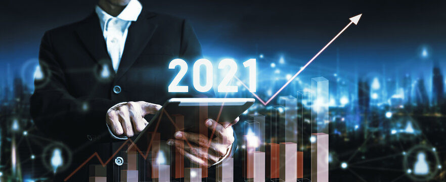 2021 New year concept of business man with tablet on online network city technology and finance background