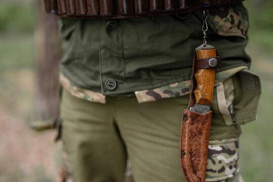 Vintage Hunting Knife on Man Belt Ammunition.