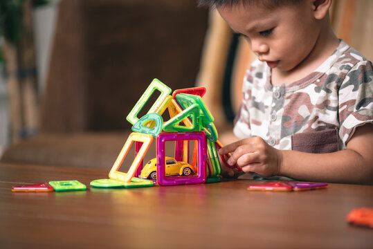 baby playing the magnetic tiles