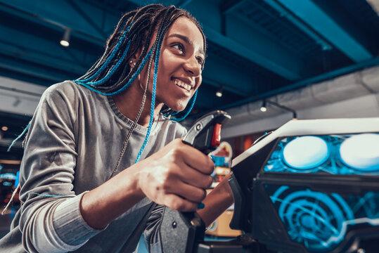 African american girl piloting plane in arcade.