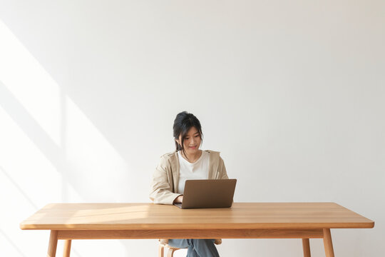 Happy Asian woman working from home