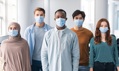 Diverse group of international people wearing face masks