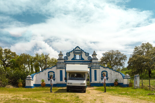 Caravan and its owners, in front of a portugheze gate