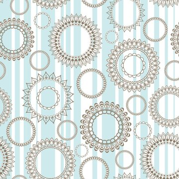 Seamless turquoise pattern with openwork circles and white vertical stripes