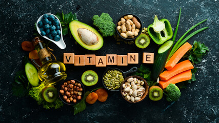 Fototapeta Foods rich in vitamin E: pumpkin, broccoli, dried apricots, parsley, avocado and vegetables. The inscription