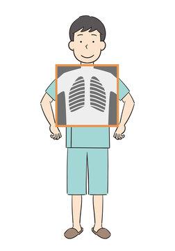 健康診断で胸部レントゲン検査を受ける男性