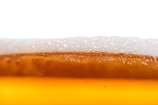 Close up of beer bubbles.