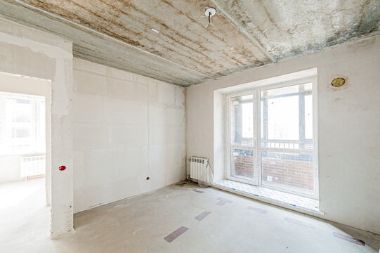 Russia, Moscow- April 17, 2020: interior room apartment rough repair for self-finishing. interior decoration, bare walls of the premises, stage of construction