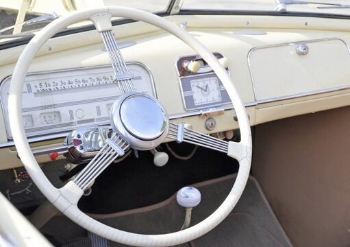 whiter interior dashboard of a vintage automobile