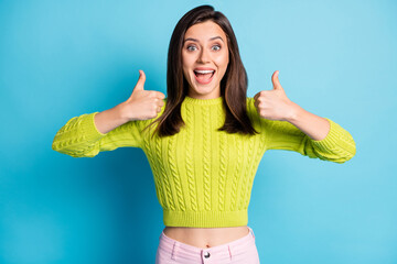 Portrait of young attractive excited happy positive girl woman female showing thumb up with open mouth isolated on blue color background