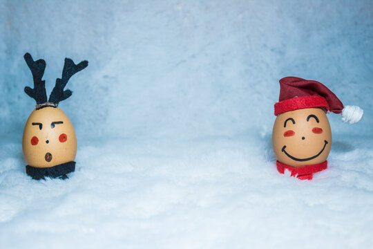 Christmas/holiday concept design by painting cute faces on two eggs
