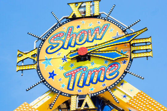 Tilburg, Netherlands - 07.22.2019: Show time symbol on an extreme carousel entrance in fun fair, market in Netherlands