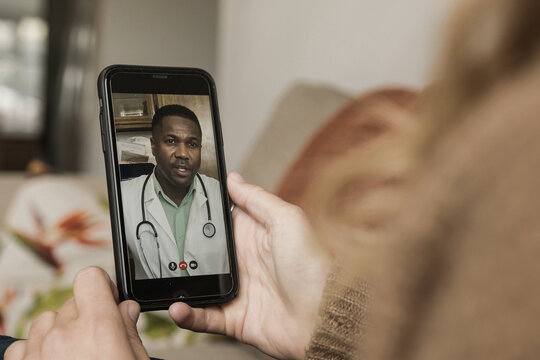 Close up of video call with doctor using smartphone