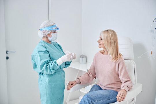 Nurse preparing for performing a PCR test